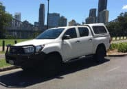Toyota Hilux Dual Cab parked on street side view